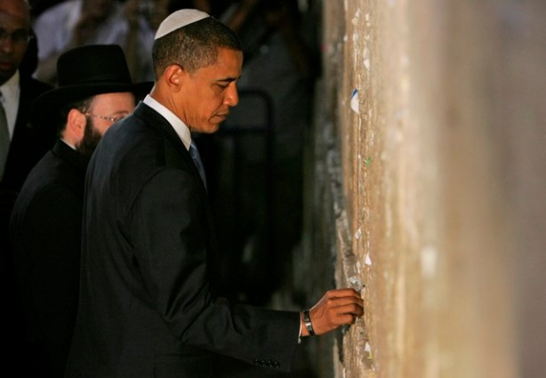 """** FILE **  In this Thursday, July, 24, 2008 file photo, U.S. Democratic presidential contender Sen. Barack Obama, D-Ill., places a not in the Western Wall, Judaism's holiest site, in Jerusalem's Old City. A written prayer that Barack Obama left this week in the cracks of the Western Wall, Judaism's holiest site, asking God to guide him and guard his family was published Friday in an Israeli paper.""""Lord _Protect my family and me,"""" the Democratic presidential candidate wrote in the note published in the Maariv daily. """"Forgive me my sins, and help me guard against pride and despair. Give me the wisdom to do what is right and just. And make me an instrument of your will."""" (AP Photo/Tara Todras-Whitehil,File)"""