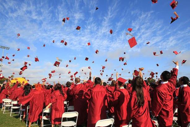 HUNTINGTON BEACH, CA, June 11, 2013 -- Graduates toss their caps in the air during the conclusion of Ocean View High School's 2013 commencement on Wednesday.  (Kevin Chang/ HB Independent)