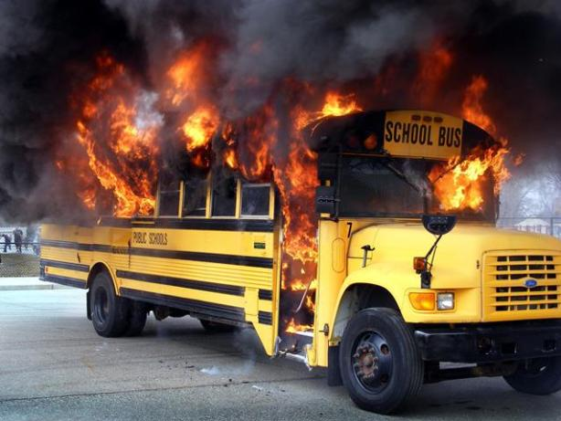 A bus is set ablaze outside Allendale Elementary School at an April 2 training class for Wayne County school bus drivers. The demonstration showed how necessary proper evacuations are, as a bus could potentially go up in flames in a mere two minutes. (Photo courtesy of Kim Hooper)