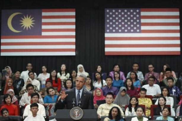 U.S. President Barack Obama gestures while speaks at a meeting with students from the Young Southeast Asian Leaders Initiative at Taylor's University in Kuala Lumpur