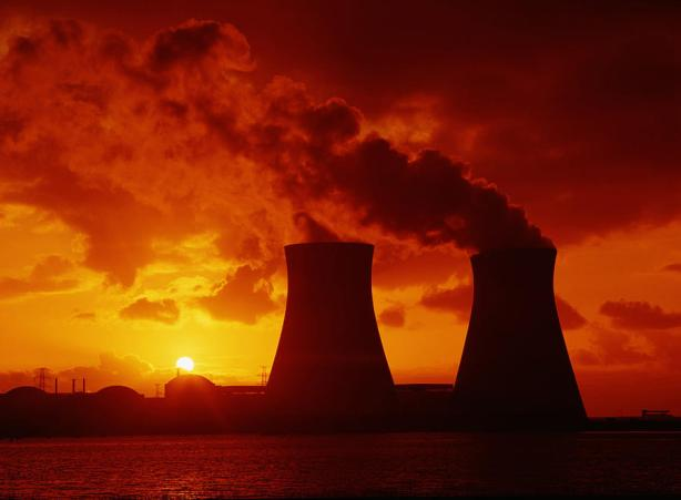 cooling-towers-emitting-steam-at-nuclear-power-plant-sunset-guy-vanderelst.jpg